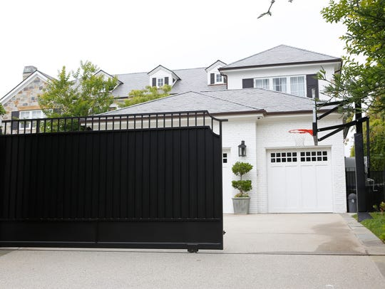 The front gate of a home belonging to LeBron James