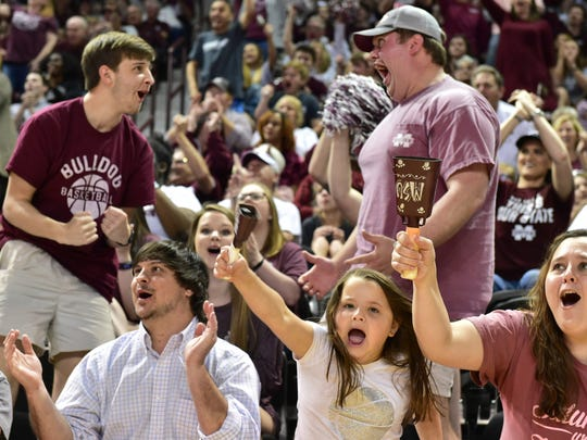 Mississippi State fans cheer as their women's baskteball team makes a turnover against Notre Dame in the final game of the Women's NCAA finals. Humphrey Coliseum opened its doors to fans for a watch party.