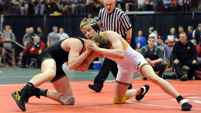 Tri-Valley's Kade Kowalski competes with Lakewood St. Edwards' Jack Conway in a third-place match Saturday during the Division I State Wrestling Tournament at the Jerome Schottenstein Center in Columbus. Kowalski lost to Conway, finishing in fourth place.