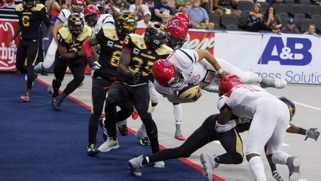Lorenzo Brown (8) of the Sioux Falls Storm dives into the end zone for a touchdown against the Iowa Barnstormers on Friday, June 8, 2018 at the Denny Sanford Premier Center in Sioux Falls, S.D.