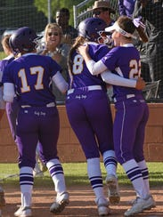 Lutcher's Molly Mohon celebrates with Makenzie Louviere