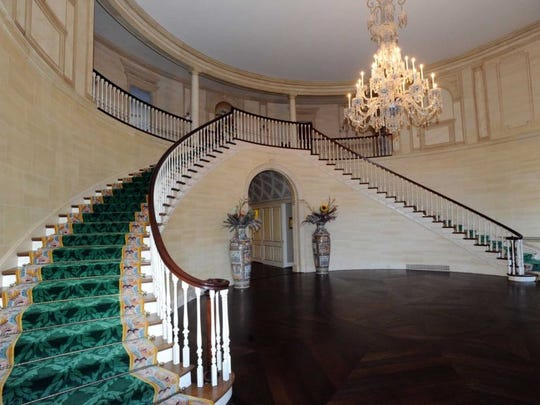 A look at the three-story rotunda foyer with a double grand staircase.