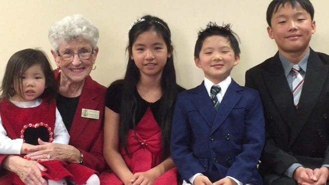 Ruth Moir (second from left) poses with children who attended the Steinway Festival competition. They are (left to right): Nina Wu, Catherine Duan, Jadon Wu and Kevin Liu.