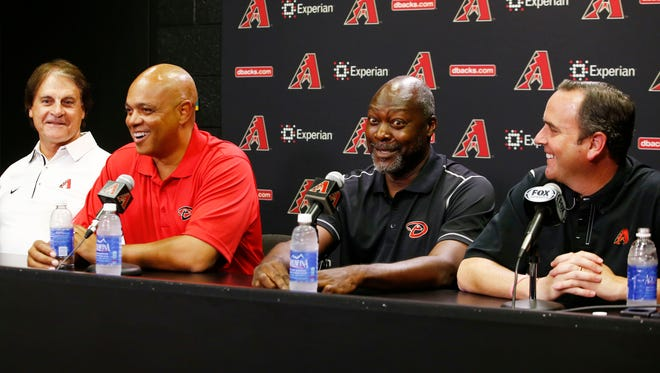 Diamondbacks introduce De Jon Watson (center-left) as their new senior VP of baseball operations and Dave Stewart (center-right) as the new GM during a press conference on Friday, Sept. 26, 2014.