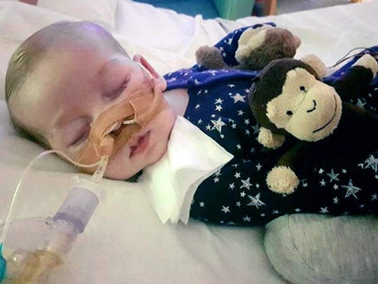 This is an undated photo of sick baby Charlie Gard provided by his family, taken at Great Ormond Street Hospital in London. A British court will assess new evidence Monday July 10, 2017, in the case of 11-month-old Charlie Gard as his mother pleaded with judges to allow the terminally ill infant to receive experimental treatment for his rare genetic disease, mitochondrial depletion syndrome.
