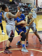 McMurry's Chyna Washington, right, and Skyler Reyna try to steal the ball from LeTourneau's Savannah Cummings during the War Hawks' 76-69 win in an American Southwest Conference matchup Thursday at Kimbrell Arena.