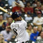 Milwaukee Brewers right fielder Ryan Braun (8) breaks his bat fouling a pitch in the fourth inning against the St. Louis Cardinals at Miller Park.