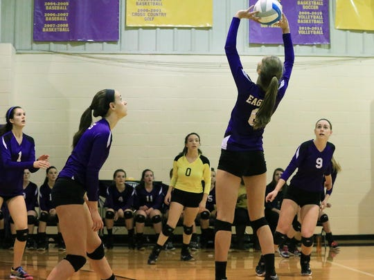 Plymouth Christian junior setter Jessica Paulson (No. 6) gets ready to pass the ball to a teammate during Tuesday's Class D volleyball regional.