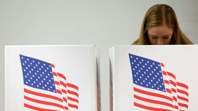 Haley Barbour casts her vote Tuesday, Oct. 25, 2016, at the early voting location at Drake University in Des Moines.