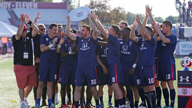 The Indy Eleven team is presented with the 2016 Spring Championship Trophy.