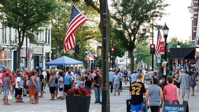 People fill the streets in downtown Waukesha during a Friday Night Live event June 29, 2018. The potential crowds are a major reason why Friday Night Live, already twice postponed in 2020, may face outright cancellation this season due to again-growing concerns about the spread of the coronavirus locally and across the country.