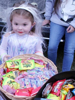 Children of all ages, dressed as a favorite character, attend a Trunk or Treat event at the Glascock County Sheriff's Office parking lot in Gibson on Saturday. Sheriff Jeremy Kelley said twice as many people and groups handed out candy compared to those at last year's event.