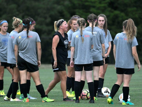 Coach Nicole Aquila and members of the Tennessee Soccer