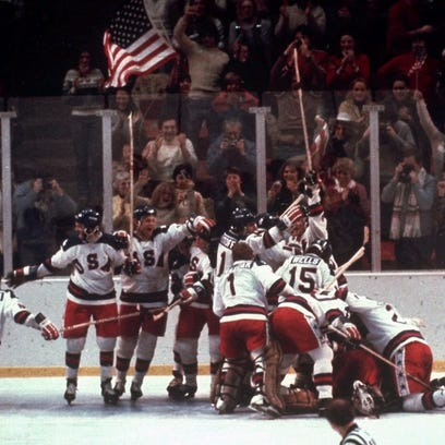 The U.S. hockey team pounces on goalie Jim Craig after