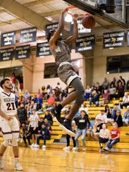 A dunk by Jahmel Myers (4) from Mariner  on March 26,