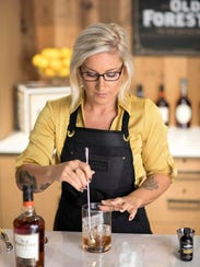 Old Forester master taster Jackie Zykan mixes an Old Fashioned.