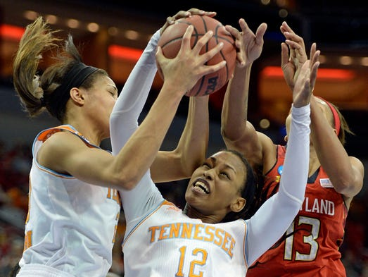 Tennessee  center Isabelle Harrison (20) and forward Bashaara Graves (12) battle Maryland center Alicia DeVaughn (13) for a rebound in the regional semifinals Sunday. Maryland defeated Tennessee 73-62.