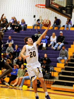 Wylie's Sam King goes for a lay up against Midland High.  The Bulldogs won 88-51.