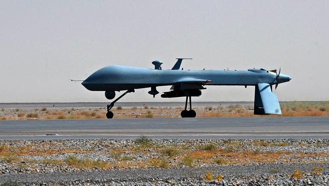 A 2010 file photo a U.S. Predator unmanned drone armed with a missile stands on the tarmac of Kandahar military airport in Afghanistan.