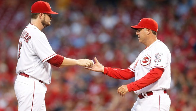 Reds starting pitcher David Holmberg is replaced by manager Bryan Price during the third inning of a game against the Braves on Aug. 21.