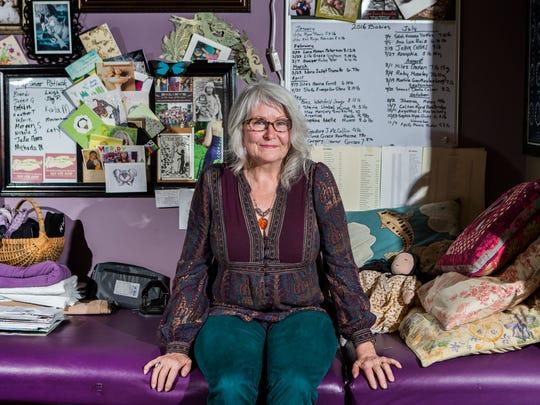 Karen Webster sits in her office at her home in Elkton, Md.