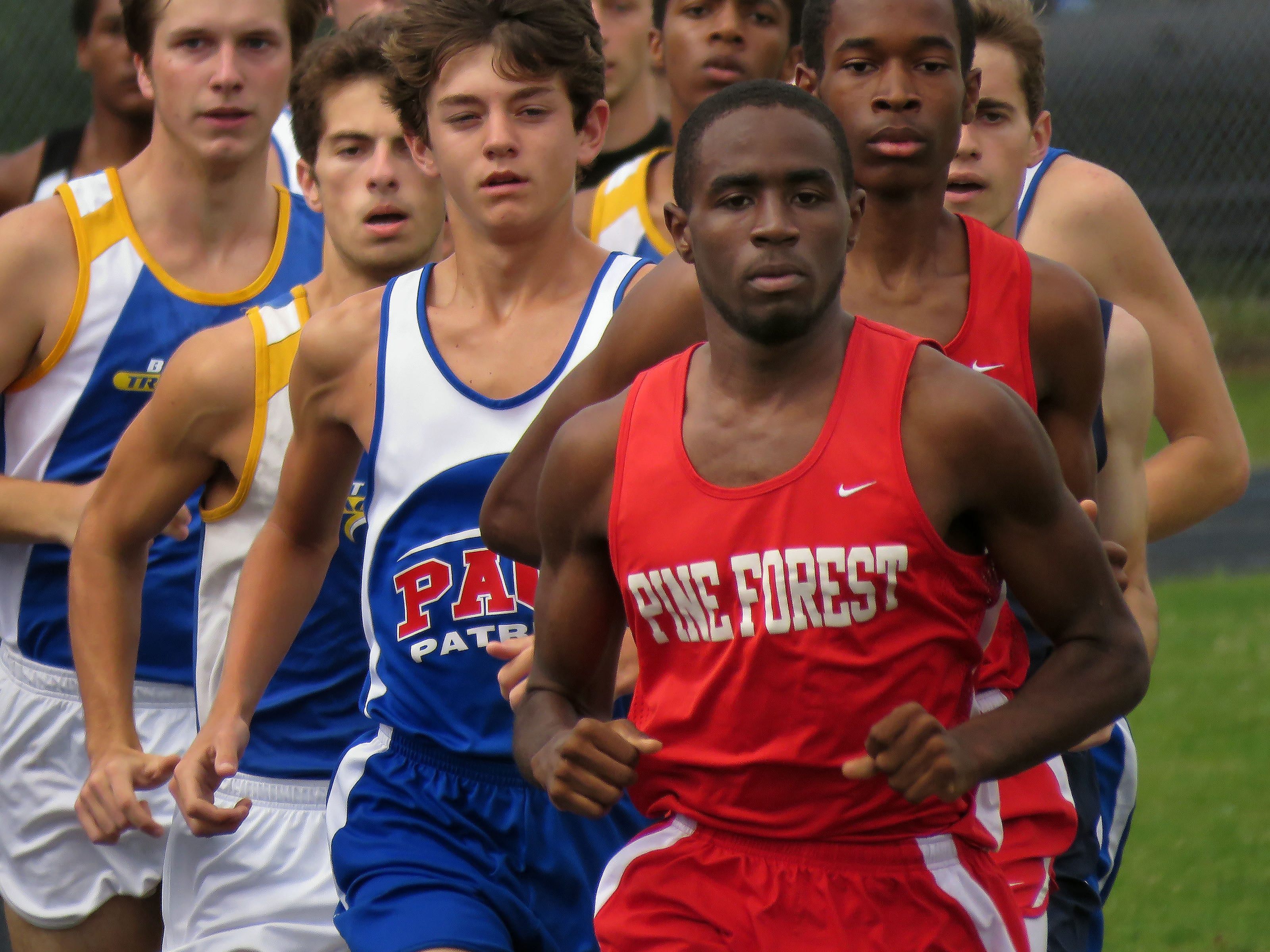 Members of the Pine Forest track team lead the boys 1600 meter event Wednesday during the District 1-3A Track and Field Championships at Washington High School.