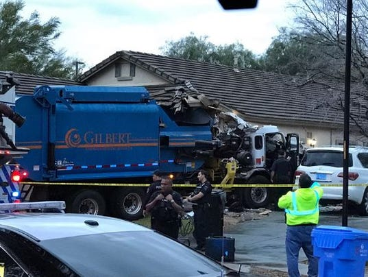 City garbage truck plows into Gilbert home