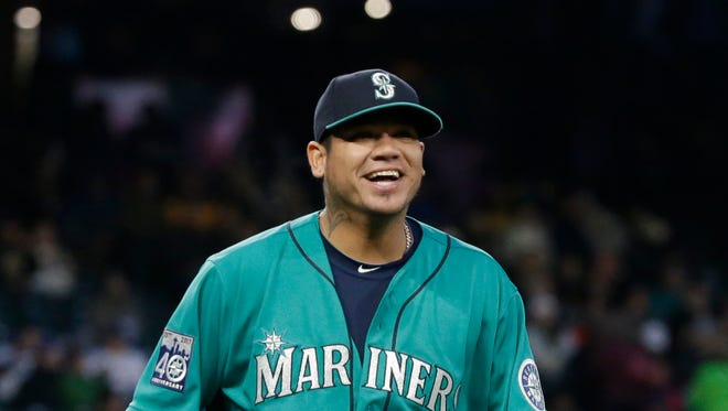 Mariners starting pitcher Felix Hernandez smiles as he heads off the field between innings against Texas on Friday night at Safeco Field.