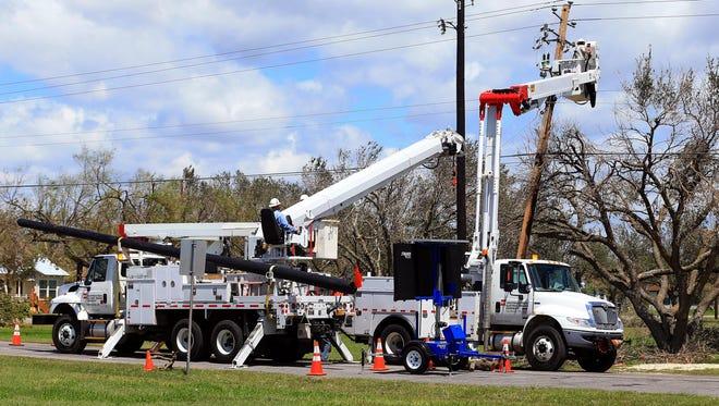 AEP workers repair power poles in Refugio, Texas