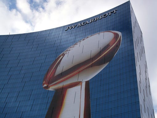 The Vince Lombardi Super Bowl trophy adorns the exterior of the JW Marriott, Friday, January 27, 2012.