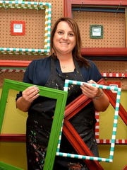 In this file photo, Sarah Williams shows off the custom signs and frames she creates.. The Framed! owner was one of several vendors at the 2016 Top of Texas at the MPEC. The vintage market, scheduled for Saturday and Sunday, is presented by the Wichita County Heritage Society.
