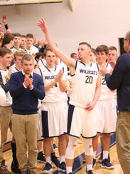 Woodmore's Mitchell Miller  acknowledges the crowd