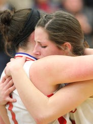 Seniors Belle Michael and Miranda Wammes, right, embrace