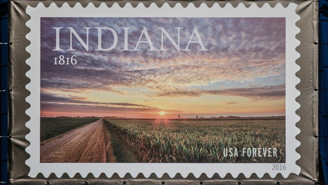 The 1816 Commemorative Forever Stamp is unveiled during the First-Day-Of-Issue Stamp Dedication Ceremony, celebrating Indiana's Bicentennial, held at the Indiana Statehouse in June 2016.