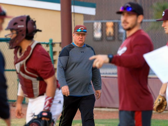 Calallen's head coach Steve Chapman talks to his players during practice Tuesday, Jan. 31, 2017, at Steve Chapman Field in Corpus Christi.