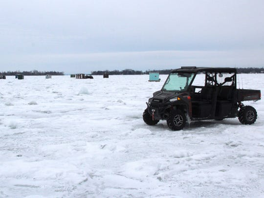 A UTV and ice fishing structures dot the ice of Green Bay near Sturgeon Bay, Wis. Photo taken Jan. 11, 2017 by Paul A. Smith.