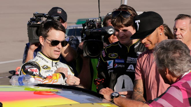 Jeff Gordon, left, chats with Ryan Blaney, Lewis Hamilton and Mario Andretti on pit road prior to his final race.