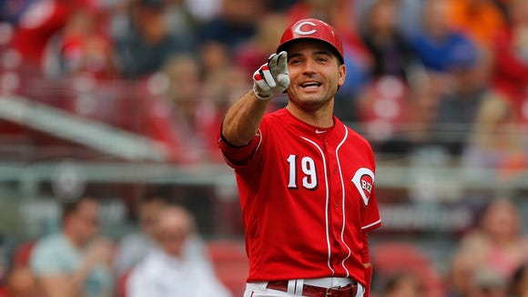 Reds first baseman Joey Votto smiles as Billy Hamilton and Brandon Phillips joke with him in the third inning.
