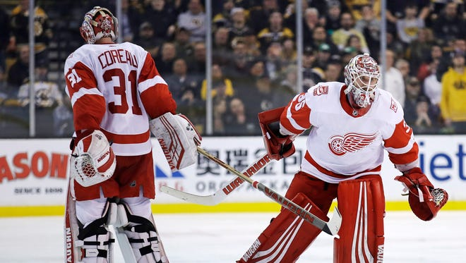 Detroit Red Wings goaltender Jimmy Howard, right, replaces Jared Coreau, during the second period in Boston, Tuesday, March 6, 2018.