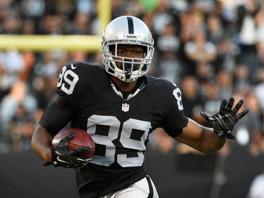 Raiders wide receiver Amari Cooper runs with the football