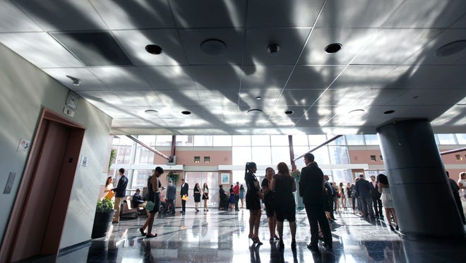 In this file photo, the afternoon sun creates shadows during the reception of the Ibero-American Action League's 19th annual scholarship award gala at the Rochester Riverside Convention Center in Rochester, N.Y. on Saturday June 14 2014.