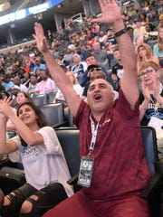 June 21, 2018 - Season ticket holder Mehdi Sadeghi (center) and his daughter Shelia react favorably to the Grizzlies choice of Jaren Jackson, Jr. during a NBA Draft watch party at The FedEx Forum on Thursday evening. (Stan Carroll/Special to The Commercial Appeal)
