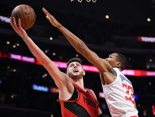 Portland Trail Blazers center Jusuf Nurkic, left, shoots as Los Angeles Clippers forward Wesley Johnson defends during the second half of an NBA basketball game, Tuesday, Jan. 30, 2018, in Los Angeles. The Trail Blazers won 104-96. (AP Photo/Mark J. Terrill)