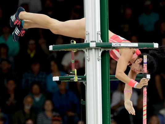 Jenn Suhr clears the bar during qualifying for the women's pole vault event at the U.S. Olympic Track and Field Trials, Friday, July 8, 2016, in Eugene Ore. (AP Photo/Charlie Riedel)