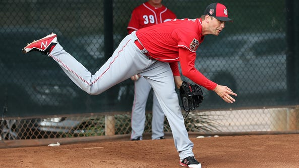 Cincinnati Reds relief pitcher Jared Hughes (48) follows