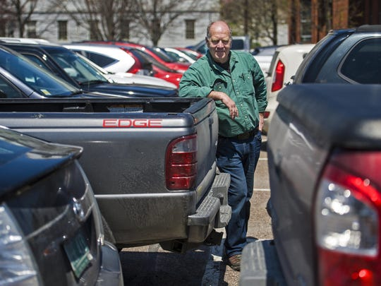 Sustainability activist Dan Jones hopes that land in Montpelier currently used as parking lots can be converted into a more environmentally-sound use that can attract people to live and work downtown. He is seen in a state government parking lot  on Wednesday.