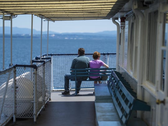 Passengers enjoy the view as the Lake Champlain Transportation Company's Adirondack ferry crosses Lake Champlain between Burlington and Port Kent.