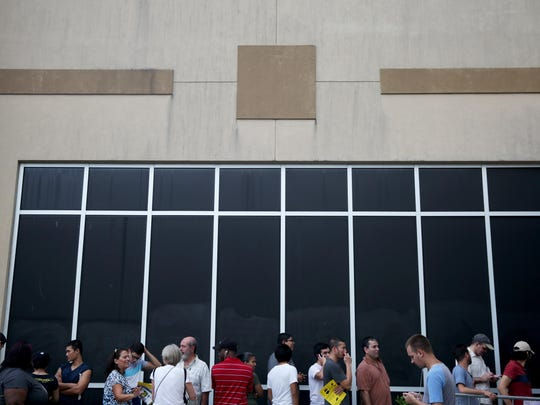 People wait in line outside Best Buy in Naples on Thanksgiving Day. Some shoppers had been in line outside the store for 24 hours.