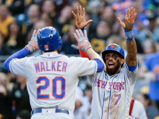 New York Mets' Neil Walker (20) is greeted at home plate by Jose Reyes after driving him in with a two-run home run in the third inning of a baseball game against the Pittsburgh Pirates, Friday, May 26, 2017, in Pittsburgh. (AP Photo/Keith Srakocic)