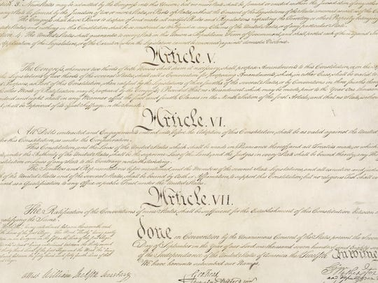 This photo made available by the U.S. National Archives shows a portion of the United States Constitution with Articles V-VII. For the past two centuries, constitutional amendments have originated in Congress, where they need the support of two-thirds of both houses, and then the approval of at least three-quarters of the states. But under a never-used second prong of Article V, amendments can originate in the states.